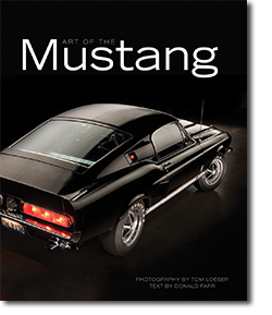 Front cover of book in black reading Art of the Mustang book with shiny black Ford Mustang from top view